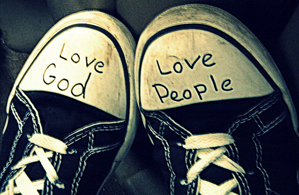 pair of converse style shoes with 'love God' and 'love people' written on them